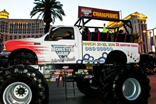 As fans gather along the sidewalks hooting and hollering, 11 Champions of Advance Auto Parts Monster Jam SM World Finals take possession of the Las Vegas Strip roaring their engines with force and precision parade style down Las Vegas Boulevard Thursday night, March 21, 2013.