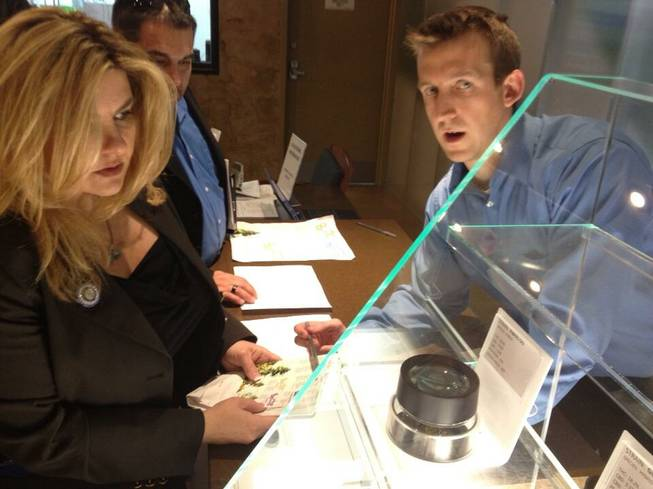 Nevada Assemblywoman Michele Fiore inspects the product and learns about the different uses for and varieties of marijuana during a trip to a dispensary in Arizona on Friday, March 22, 2013.