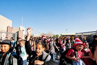 Hundreds of students flood the playground to start their day at the overcrowded, with an enrollment of 1240 students, and also the largest elementary school in Las Vegas, William V. Wright Elementary, Friday, March 22, 2013.