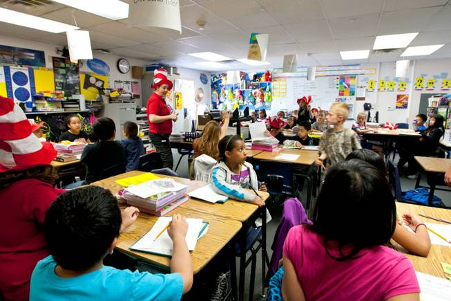 With barely enough room to pass between desks, students in Mr. Gularte's fourth-grade class begin their morning learning in a classroom of 35 students exceeding the average of 30 students at William V. Wright Elementary School, Friday, March 22, 2013.