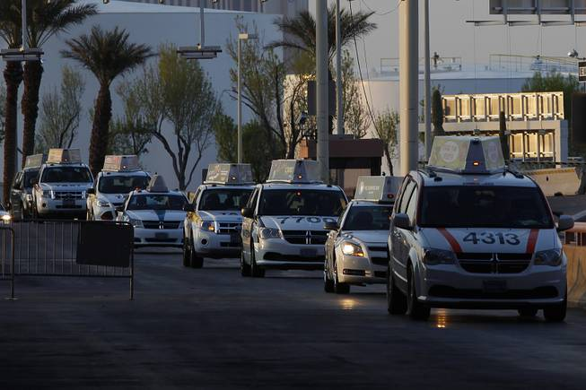 Taxis are seen queued up at McCarran International Airport Friday, March 22, 2013.