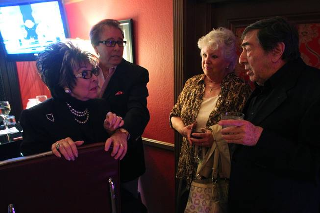 Lorraine Hunt-Bono and Dennis Bono talk with Sue and Mike DiBari at the recently remodeled Italian American Social Club Saturday, March 23, 2013.