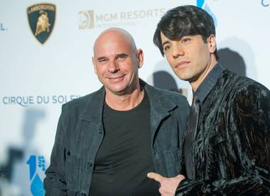 "Guy Laliberte and Criss Angel arrive on the blue carpet for Cirque du Soleil's ""One Night for One Drop"" at Hyde Bellagio on Friday, March 22, 2013."