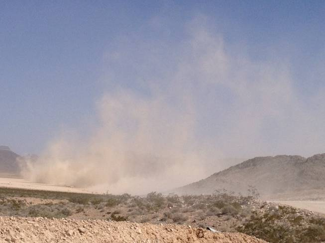 Dust rises from the desert near Las Vegas on Saturday, March 23, 2013, during the Mint 400 off-road race. The race was first run in 1967 and has featured some of the most famous race drivers in history, including Indianapolis 500 drivers Al Unser and Parnelli Jones.