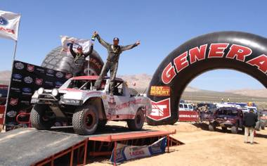 Joey Hererra, left, and P.J. Guglielmo celebrate a class-winning finish Saturday, March 23, 2013, in the Mint 400 off-road race near Las Vegas.