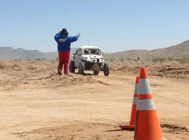 Competitors in the Mint 400 get a wave. The race was held on Saturday, March 23, 2013, near Las Vegas.