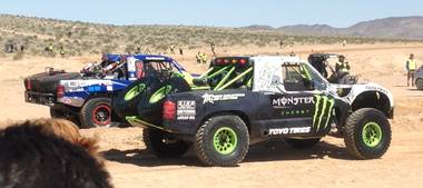 Trucks roll to the starting line of the Mint 400 off-road race on Saturday, March 23, 2013, near Las Vegas.