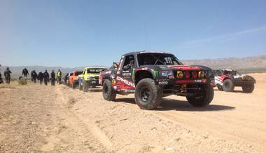 Competitors stage for the start of the Mint 400 off-road race Saturday, March 23, 2013, near Las Vegas. The event drew more than 1,000 entrants in 19 pro classes and two sportsman classes.
