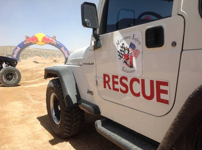 A rescue vehicle sits near the course of the Mint 400 off-road race on Saturday, March 23, 2013, near Las Vegas.