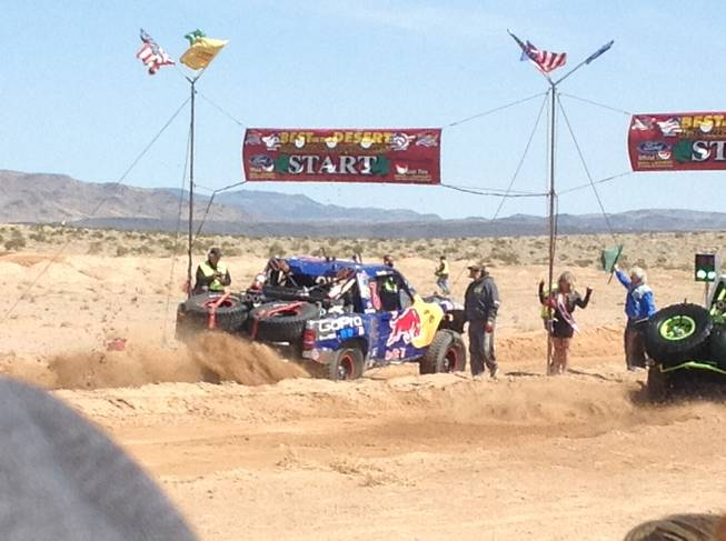A truck roars off the start line Saturday, March 23, 2013, during the Mint 400 off-road race near Las Vegas.