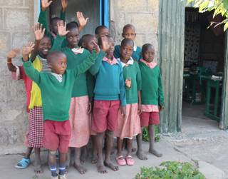 Children who attend Oloibormurt Primary School in Kenya's Maasai Mara region wave goodbye to a visiting party from the U.S., which included Moreno brothers Frankie, Tony and Ricky.
