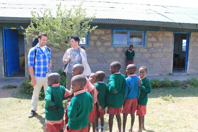 Frankie and Tony Moreno are welcomed by school children at Oloibormurt Primary School in Kenya's Maasai Mara region.