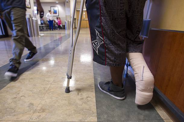 A patient stands in the emergency room lobby after being treated for a moped accident at Sunrise Hospital Monday, March 25, 2013.