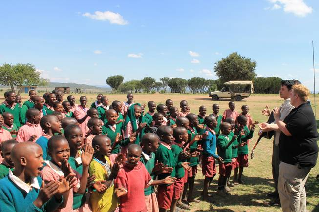 Children at Oloibormurt Primary School in the Maasai Mara region of southeast Kenya sing with Frankie Moreno and his brothers Ricky and Tony.