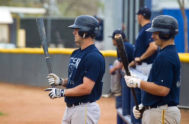 College of Southern Nevada's Cody Clark, left, prepares to bat during practice at Morse stadium in Henderson, Tuesday, March 26, 2013. Bryce Harper, a former CSN player now with the Washington Nationals, recently donated 40 new and used professional bats to the CSN baseball team.