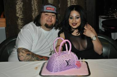 "Austin ""Chumlee"" Russell and Tanya Hyjazi at Andiamo Italian Steakhouse in The D Hotel."