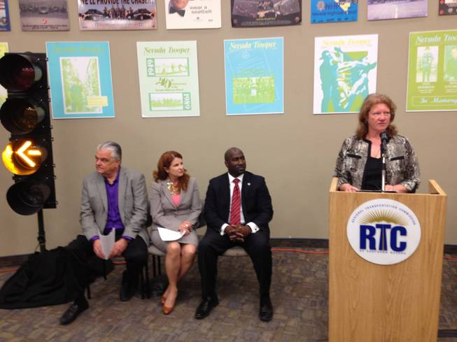 Nevada Department of Transportation assistant director Tracy Larkin-Thomason discusses Nevada's flashing yellow arrow traffic signal at a news conference Tuesday, March 26. Larkin-Thomason was joined by Clark County Commissioner Steve Sisolak (left), Henderson Councilwoman Debra March (middle) and Las Vegas Councilman Ricki Barlow (right) to discuss the traffic signals.