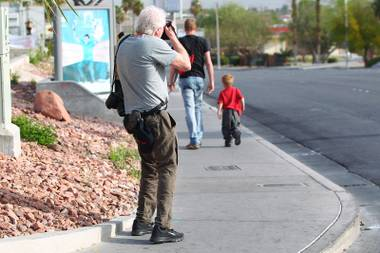 New York-based photographer Craig Blankenhorn photographs Tom and his son Kaleb heading to a bus stop as part of his larger project focusing on youth and homelessness Wednesday, March 27, 2013.