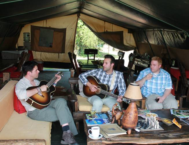 Frankie, Tony and Ricky Moreno work out a new song in the main tent at Porini Mara Camp in southeast Kenya.