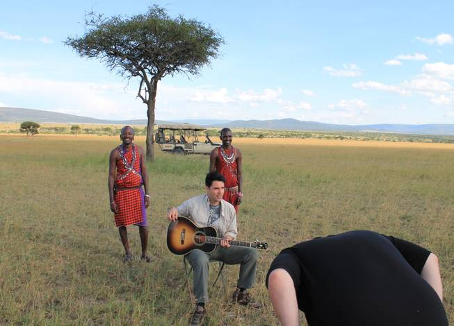 Frankie Moreno and Porini Mara Camp guides Geoffrey Risa Ketere and Ripa Olmara prep for a video being set up by Ricky Moreno in the Ol Kinyei Conservancy in southeastern Kenya.