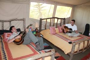 "Frankie and Tony Moreno work out the chorus for ""Hello World"" in their tent at Porini Mara Camp in Ol Kinyei Conservancy in southeastern Kenya."