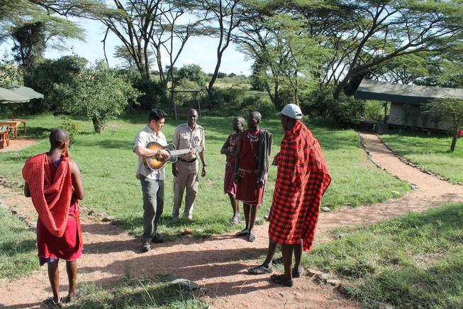 "Frankie Moreno gives direction to the staff at Ol Kinyei Conservancy, including Porini Camp manager Harry Maina, for a video of the song ""Lions Den."""