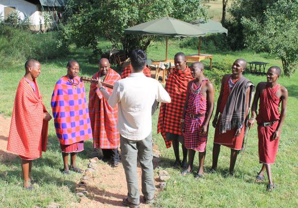 Frankie Moreno directs a group of Maasai tribesmen who work at Porini Mara Camp for a music video for his song