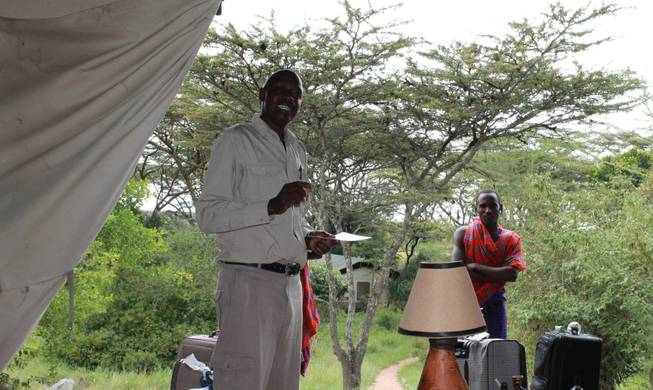 Harry Maina, manager of Porini Mara Camp in Ol Kinyei Conservancy in southeastern Kenya, gives guests a tutorial about the region.