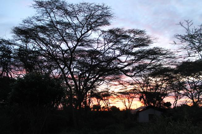 The sun sets over a resident tent at Point Morini at Ol Kinyei Conservancy in southeast Kenya.