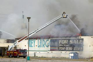 Clark County and City of Las Vegas firefighters battle a four-alarm fire at the old Key Largo Casino on Flamingo Avenue and Paradise Road Thursday, March 28, 2013.