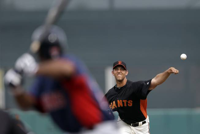 San Francisco Giants starting pitcher Madison Bumgarner throws to the Cleveland Indians' Michael Bourn during the first inning of an exhibition spring training baseball game on Tuesday, March 5, 2013 in Scottsdale, Ariz.