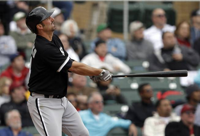 Chicago White Sox's Paul Konerko watches his three-run home run against the Arizona Diamondbacks during the fifth inning of an exhibition spring training baseball game on Saturday, March 9, 2013 in Scottsdale, Ariz.