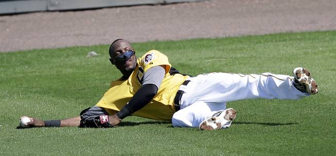 Pittsburgh Pirates left fielder Starling Marte loses his sunglasses after missing a fly ball during a baseball spring training intrasquad game, Friday, Feb. 22, 2013, in Bradenton, Fla.