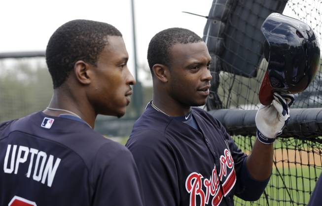 Atlanta Braves outfielder B.J. Upton (2) and his brother Justin Upton wait to bat during a spring training baseball workout Friday, Feb. 15, 2013, in Kissimmee, Fla.