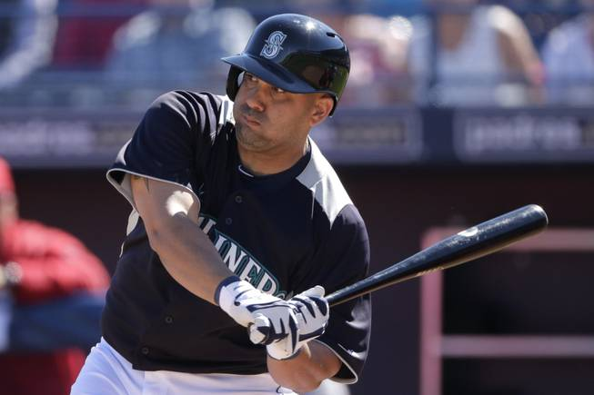 Seattle Mariners' Kendrys Morales bats during an exhibition spring training baseball game against the Los Angeles Angels Monday, Feb. 25, 2013, in Peoria, Ariz.