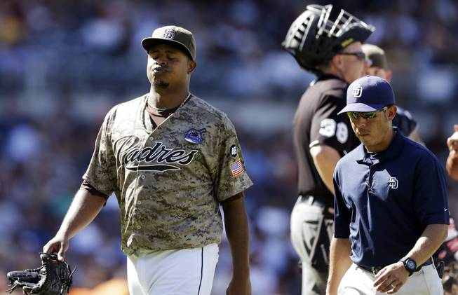 San Diego Padres starting pitcher Edinson Volquez reacts as he leaves the field while playing the San Francisco Giants during the fifth inning in a baseball game in San Diego, Sunday, Sept. 30, 2012. The Giants won 7-5.