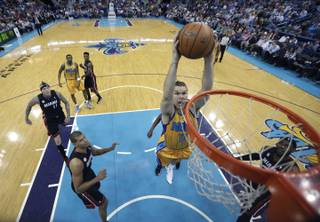 New Orleans Hornets power forward Lou Amundson (17) slam dunks in the first half of an NBA basketball game against the Miami Heat in New Orleans, Friday, March 29, 2013.