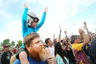 Degan Marvick sits on his father Drew Marvick's shoulders during The Aquabats set during the Extreme Thing Sports & Music Festival at Desert Breeze Park.Saturday, March 30, 2013.
