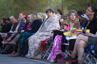 People wait for the start of the 28th annual Easter sunrise service at Palm Eastern Mortuary and Cemetery Sunday, March 31, 2013.