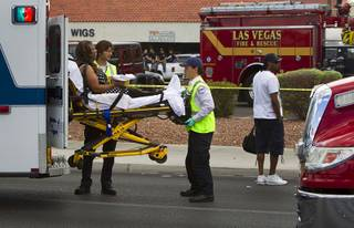 A woman is loaded into an ambulance outside the Egg and I restaurant on West Sahara Avenue Monday April 1, 2013. As many as 10 people were injured when a Lexus sedan left the roadway and crashed into the restaurant.