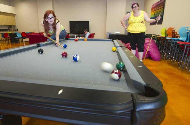 Gaylyn Daniels, left, and Alicia Wade play billiards in the youth room at the Gay and Lesbian Community Center of Southern Nevada, 401 S. Maryland Pkwy, Monday, April 1, 2013. There will be a grand opening for the center on Saturday, April 6, form 10 a.m. to 4 p.m.
