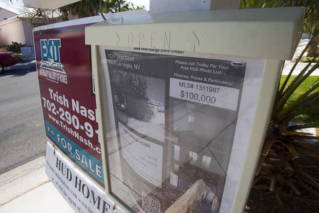 A sign is posted outside a vacant HUD home in North Las Vegas April 2, 2013. A neighbor said that it has been vacant for a bout two years. (1524 Gaber Court, North Las Vegas)