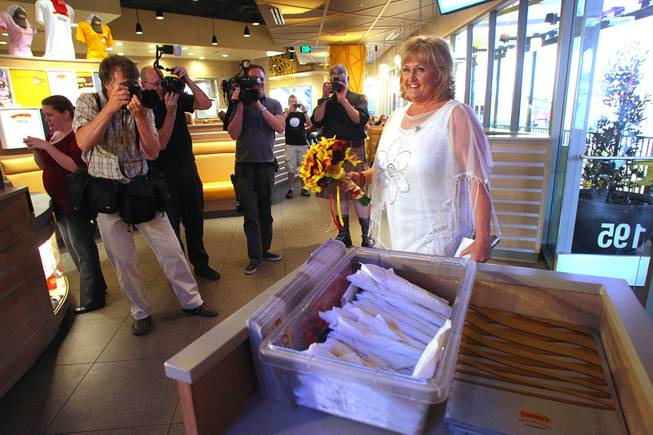 Nancy Levandowski makes her entrance into the Denny's restaurant on Fremont Street for her wedding to Steve Keller Wednesday, April 3, 2013.
