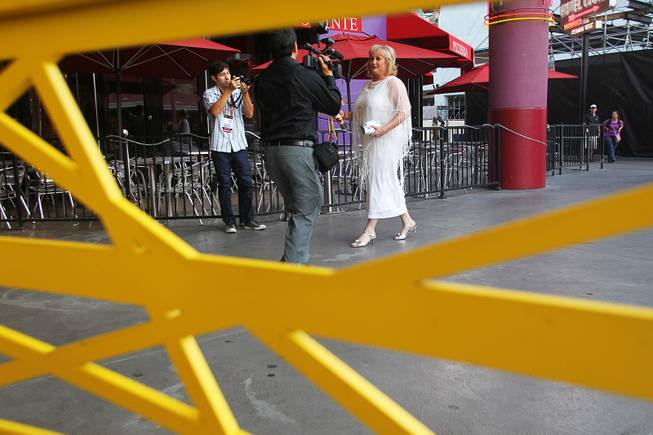 Nancy Levandowski is followed by cameras as she makes her way to the Denny's restaurant on Fremont Street for her wedding ceremony with Steve Keller Wednesday, April 3, 2013.