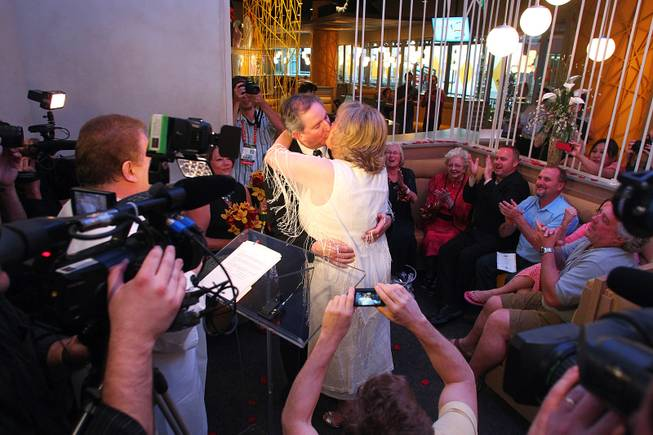 Nancy Levandowski and Steve Keller kiss after exchanging wedding vows at the Denny's restaurant on Fremont Street Wednesday, April 3, 2013.