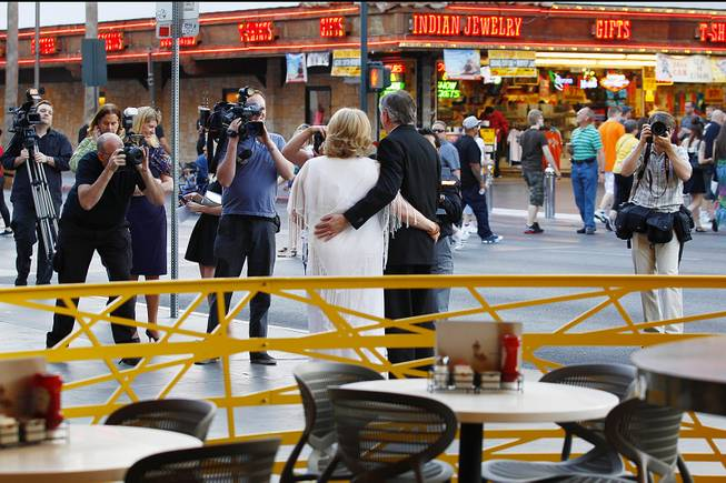 Ames, Iowa, residents Nancy Levandowski and Steve Keller have their photo taken and video shot after exchanging wedding vows at the Denny's restaurant on Fremont Street Wednesday, April 3, 2013.