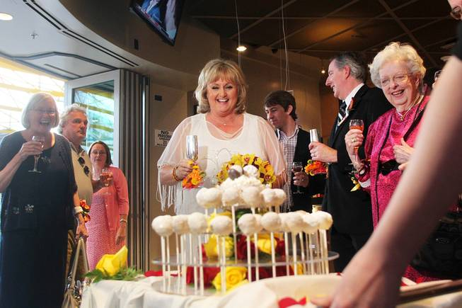 Nancy Levandowski reacts as her wedding cake is wheeled out after exchanging vows with Steve Keller at the Denny's restaurant on Fremont Street Wednesday, April 3, 2013.