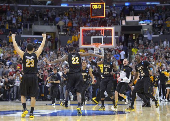 Wichita State players celebrate their 70-66 win over Ohio State in the West Regional final in the NCAA men's college basketball tournament, Saturday, March 30, 2013, in Los Angeles.
