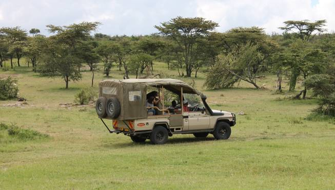 A Toyota Land Cruiser -- the chosen vehicle at Porini Mara Camps -- cruises through Ol Kinyei Conservancy in southeastern Kenya.