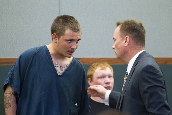 Gage James Lindsey, 18, speaks to attorney Sean Sullivan at the Regional Justice Center Thursday, April 4, 2013. Lindsey is facing charges related to the Monday accident at the Egg & I restaurant that injured 10 people.